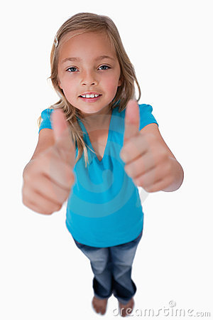 Portrait of a young girl with the thumbs up