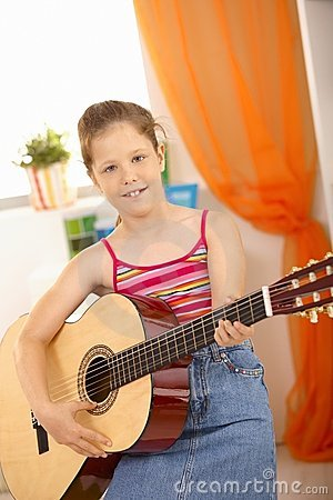 Portrait of young guitar player