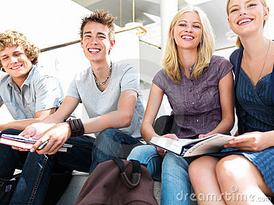 Portrait of a young guys and girls sitting togethe