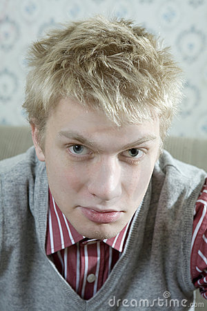 portrait of young handsome blond man