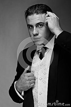 Portrait of young handsome groom in suit