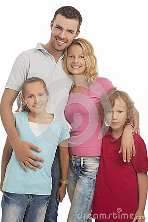 Portrait of young happy caucasian family standing together with