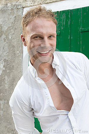 Portrait of young happy smiling blond caucasian man - attractive
