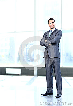 Portrait of young happy smiling cheerful business man