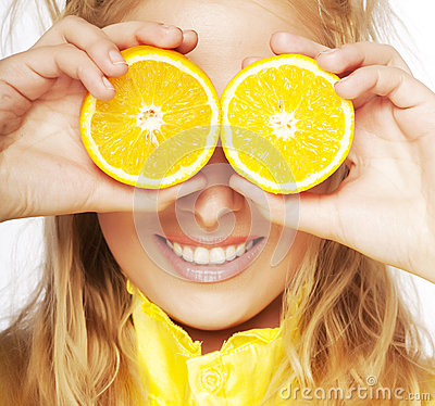 Portrait on young and healthy woman with orange
