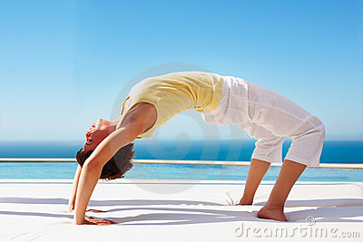 Portrait of a young lady practicing yoga