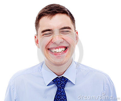 Portrait of young laughing businessman