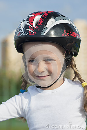 Portrait of young little skater girl