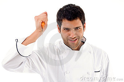 Portrait of young male chef holding dagger