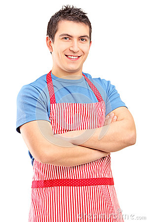 A Portrait Of Young Male Wearing Apron And Posing