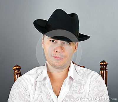 Portrait of young man in a hat