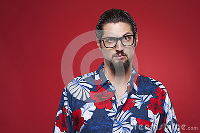 Portrait of a young man in Hawaiian shirt with raised eyebrow