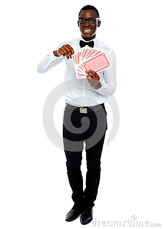 Portrait of a young man holding cards