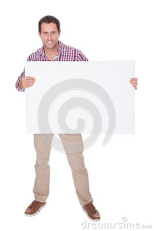 Portrait Of Young Man Holding Placard