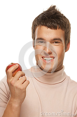 Portrait of young man holding red apple