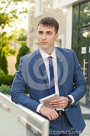portrait of a young man professional banker working on touch pad while standing in modern office space interiorpurposeful male en stock photo image banker office space