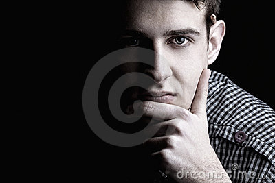Portrait of young man thinking 2