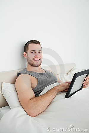 Portrait of a young man using a tablet computer