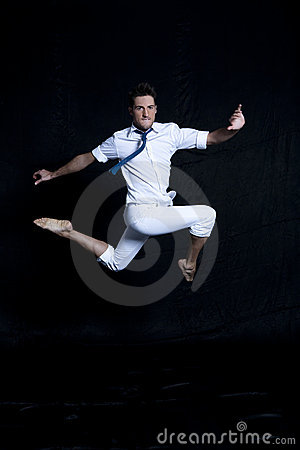 Portrait of young man in white jumping gracefully
