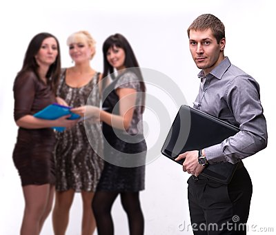 Portrait of young man with laptop with group of people