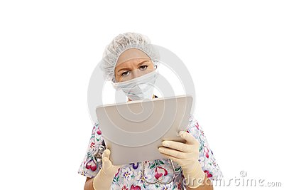 Portrait of young nurse using computer