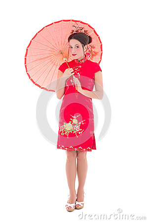 Portrait of young pretty woman in red japanese dress with umbrel