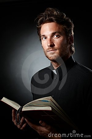 Portrait of young priest with Bible.