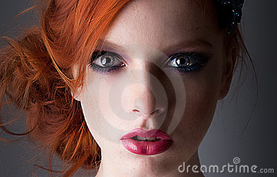 Portrait of young red haired freckled girl closeup