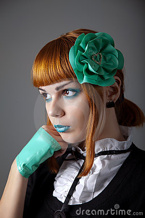 Portrait of young redhead woman with blue make-up