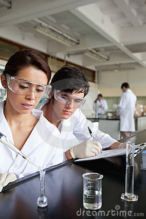 Portrait of young science students working