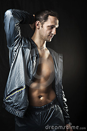 Portrait of young sexy man in sportswear.