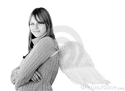 Portrait of a young smiling girl with angel wings
