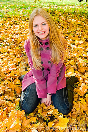 Portrait of young smiling woman on the ground