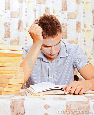Portrait of young student who is learning hard