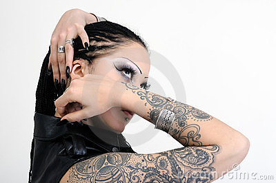 Portrait of young tattooed stylish woman