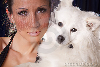 Portrait of young widow woman and white dog