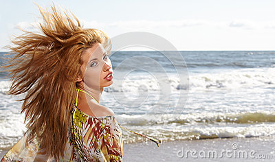 Portrait young woman on beach