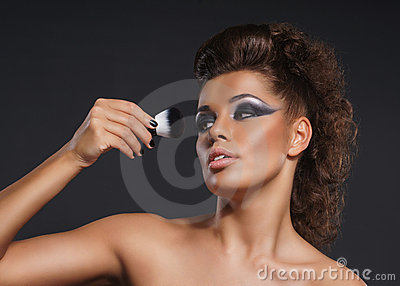 Portrait of a young woman in a beautiful makeup