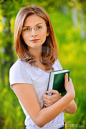 Portrait of young woman with book