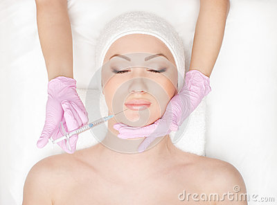 Portrait of a young woman on a botox procedure