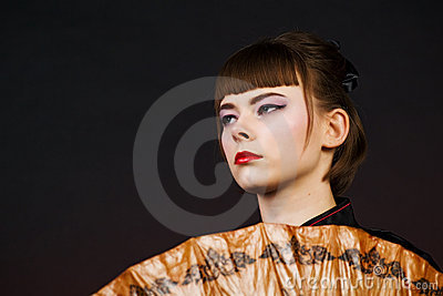 Portrait of young woman on a dark background