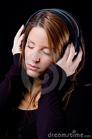Portrait of young woman enjoying music