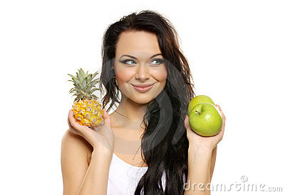 Portrait of a young woman with fresh fruits