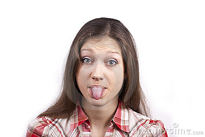 Portrait of a young woman with her tongue out
