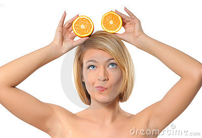 Portrait of a young woman holding fresh oranges