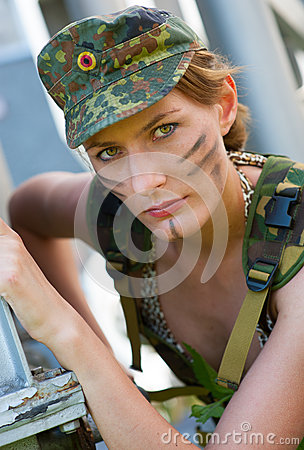 Portrait of young woman in military camouflage