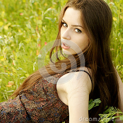 Portrait of young woman at nature