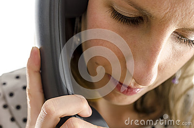 Portrait of a young woman on a phone