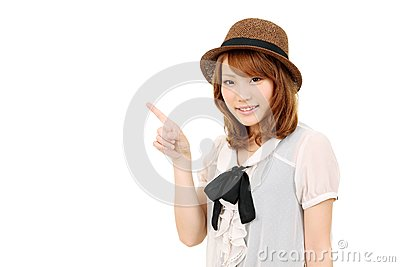 Portrait of young woman pointing