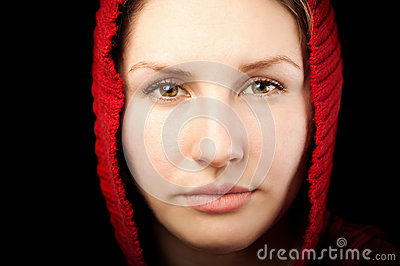 Portrait of young woman with red hood